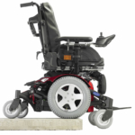 Invacare TDX SP2 HD going over an obstacle